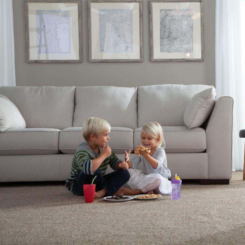 kids playing on carpet in living room | Flowers Flooring