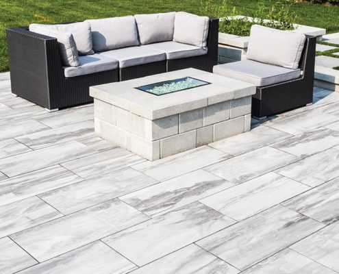 outdoor living space with porcelain tile floor