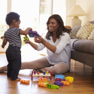 Mother And Son Playing With Toys | Flowers Flooring