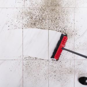 Broom Cleaning Dirt On Tiled Floor | Flowers Flooring