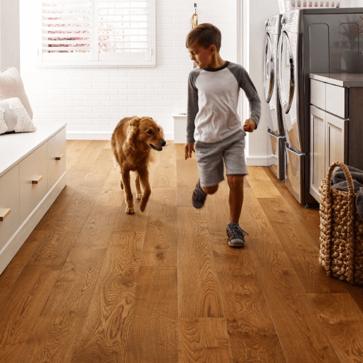 Kid and dog playing | Flowers Flooring